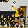 Pioneer Panthers defensive specialist Mackenzie Robinson (32) hits the ball during a game between the Pioneer Panthers and Logansport Berries at Pioneer Jr./Sr. High School in Royal Center on Tuesday, Aug. 31, 2021.