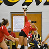 Logansport Berries' Laine McLochlin (11) goes for a kill during a game between the Pioneer Panthers and Logansport Berries at Pioneer Jr./Sr. High School in Royal Center on Tuesday, Aug. 31, 2021.