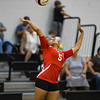 Logansport Berries' Ambria Gittings (5) serves during a game between the Pioneer Panthers and Logansport Berries at Pioneer Jr./Sr. High School in Royal Center on Tuesday, Aug. 31, 2021.