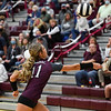 Winamac Warriors middle hitter McKenzie Hinz (11) chases a ball during a game between the Winamac Warriors and Pioneer Panthers at Winamac Community High School on Thursday, Sept. 23, 2021.