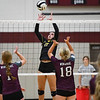Pioneer Panthers Mandee Weisenburger (17) sets the ball over the net during a game against the Winamac Warriors at Winamac Community High School on Thursday, Sept. 23, 2021.