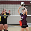 Winamac Warriors setter Kaya Campbell (18) sets during a game between the Winamac Warriors and Pioneer Panthers at Winamac Community High School on Thursday, Sept. 23, 2021.