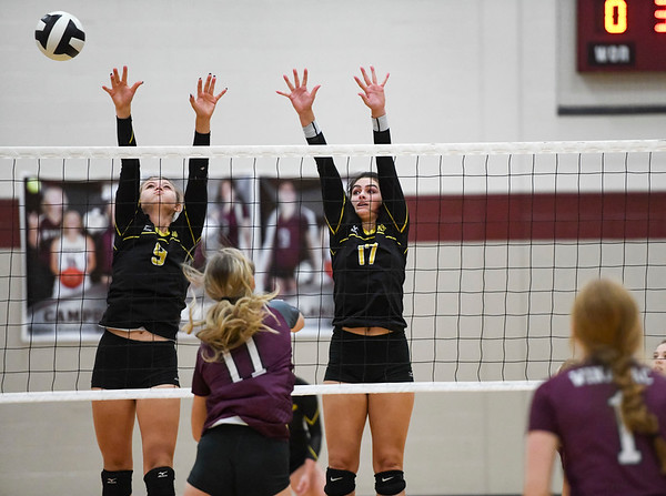 Pioneer Panthers Mandee Weisenburger (17) and middle blocker Brooklyn Borges (9) try to block a kill from Winamac Warriors middle hitter McKenzie Hinz (11) during a game between the Winamac Warriors and Pioneer Panthers at Winamac Community High School on Thursday, Sept. 23, 2021.