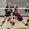 A Winamac Warriors player tries to hit the ball before it falls during a game between the Winamac Warriors and Pioneer Panthers at Winamac Community High School on Thursday, Sept. 23, 2021.