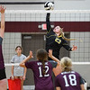 Pioneer Panthers outside hitter Hailey Cripe (23) goes for a kill during a game against the Winamac Warriors at Winamac Community High School on Thursday, Sept. 23, 2021.
