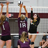 Pioneer Panthers Mandee Weisenburger (17) goes for a kill during a game between the Winamac Warriors and Pioneer Panthers at Winamac Community High School on Thursday, Sept. 23, 2021.