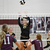 Pioneer Panthers middle blocker Kennedy Corn (27) sets over the net during a game between the Winamac Warriors and Pioneer Panthers at Winamac Community High School on Thursday, Sept. 23, 2021.