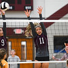 Winamac Warriors middle hitter Alyssa Villanueva (9) and middle hitter McKenzie Hinz (11) try to block a kill during a game between the Winamac Warriors and Tippecanoe Valley Vikings at Winamac High School on Tuesday, Aug. 24, 2021.