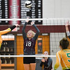 Winamac Warriors setter Kaya Campbell (18) tries to block a hit during a game between the Winamac Warriors and Tippecanoe Valley Vikings at Winamac High School on Tuesday, Aug. 24, 2021.