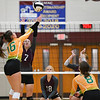 Winamac Warriors setter Chloe Rausch (7) tries to block a kill attempt during a game between the Winamac Warriors and Tippecanoe Valley Vikings at Winamac High School on Tuesday, Aug. 24, 2021.