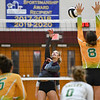 Winamac Warriors middle hitter McKenzie Hinz (11) hits the ball during a game between the Winamac Warriors and Tippecanoe Valley Vikings at Winamac High School on Tuesday, Aug. 24, 2021.