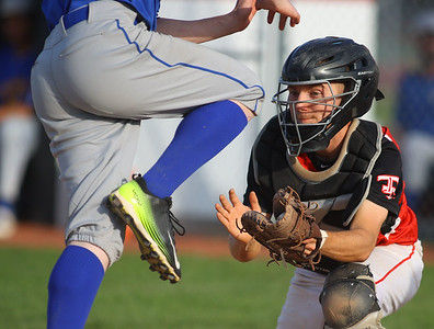 4-27-21 Taylor vs Tri-Central baseball Taylor's catcher Kendall Lanning gets TC's Trevor Philapy out at home as Philapy tumbles over him at the plate. Kelly Lafferty Gerber | Kokomo Tribune