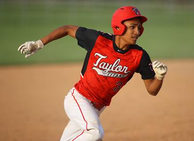 4-27-21 Taylor vs Tri-Central baseball Taylor's Jaylen Harris runs home. Kelly Lafferty Gerber   Kokomo Tribune