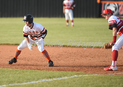 Andrew Floyd of Raceland takes a lead at first as Boyd County's Luke Patton holds on Tuesday at Raceland.  MARTY CONLEY/ FOR THE DAILY INDEPENDENT