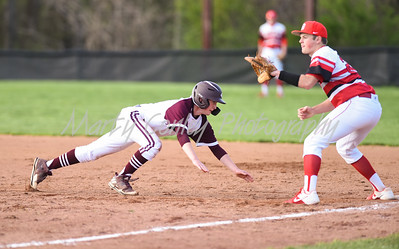 Eli Miller of Ashland hustles back to first as Boyd County's Luke Patton awaits the throw on Monday at Ashland.  MARTY CONLEY/ FOR THE DAILY INDEPENDENT