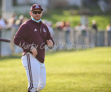 Ashland head coach, Evan Yongue looks on between innings against Boyd County on Monday at Ashland.  MARTY CONLEY/ FOR THE DAILY INDEPENDENT