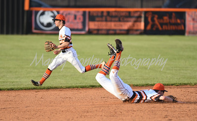 A Boyd County base hit gets between Raceland's Conner Hughes and a diving Kirk Pence on Tuesday at Raceland.  MARTY CONLEY/ FOR THE DAILY INDEPENDENT