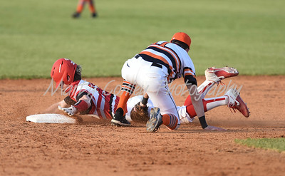 Raceland's Kirk Pence gets the tag on Boyd County's Brad Newsome for the out on Tuesday at Raceland.  MARTY CONLEY/ FOR THE DAILY INDEPENDENT