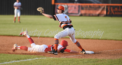Alex Martin of Boyd County gets back to first as Raceland's Clay Coldiron awaits the throw on Tuesday at Raceland.  MARTY CONLEY/ FOR THE DAILY INDEPENDENT