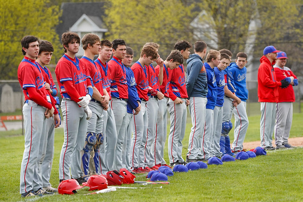 Caston Comets line up for the national anthem before the game on Saturday, April 17, 2021 in Rochester.