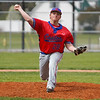 Caston Comets pitcher Pete DuVall (28) throws a pitch during the first inning of a game between the Rochester Zebras and Caston Comets on Saturday, April 17, 2021 in Rochester.
