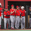 Logansport Berries players react to a three-run homer by catcher Ethan Denny (13) during the first inning of a game between the Logansport Berries and Peru Tigers on Friday, April 23, 2021 in Logansport.