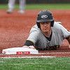 A Peru Tigers runner slides back to first base during the first inning of a game between the Logansport Berries and Peru Tigers on Friday, April 23, 2021 in Logansport.