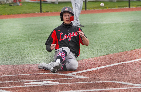 Logansport Berries shortstop Gavin Smith (23) slides to home during the fourth inning of a game between the Logansport Berries and Twin Lakes Indians on Saturday, April 10, 2021 in Logansport.