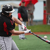 Logansport Berries infielder Mike Meadows (27) makes contact with a pitch during the fifth inning of a game between the Logansport Berries and Twin Lakes Indians on Saturday, April 10, 2021 in Logansport.