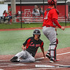 Logansport Berries outfielder John Scott (2) slides into home as the Twin Lakes Indians catcher waits for the ball during the fourth inning of a game between the Logansport Berries and Twin Lakes Indians on Saturday, April 10, 2021 in Logansport.