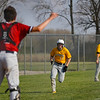 Pioneer Panthers outfielder Gavin Clem (17) rounds third and heads home as the Tri-County Cavaliers catcher waves for the ball during the first inning of a game between the Tri-County Cavaliers and Pioneer Panthers on Tuesday, April 6, 2021 in Royal Center.