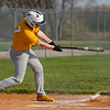 Pioneer Panthers outfielder Gavin Clem (17) hits a ground ball during the first inning of a game between the Tri-County Cavaliers and Pioneer Panthers on Tuesday, April 6, 2021 in Royal Center.