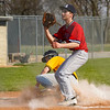 Pioneer Panthers infielder Hunter Klepinger (44) slides home after a wild pitch during the first inning of a game between the Tri-County Cavaliers and Pioneer Panthers on Tuesday, April 6, 2021 in Royal Center.