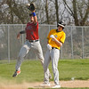 Tri-County Cavaliers infielder Xavier Cantrell (8) catches a late throw from the catcher after Pioneer Panthers infielder Hunter Klepinger (44) stole third on a wild pitch during the first inning of a game between the Tri-County Cavaliers and Pioneer Panthers on Tuesday, April 6, 2021 in Royal Center.
