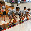 High school athletes from across the state practice dribbling drills during a basketball camp at the Berry Bowl in Logansport on Tuesday, July 20, 2021.