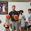 Nate Champion, head coach at Le Moyne College and former-Logansport Berry, explains a drill to high school athletes during a basketball camp at the Berry Bowl in Logansport on Tuesday, July 20, 2021.