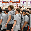 High school athletes from across the state huddle up before a basketball camp hosted by former-Logansport Berry and Le Moyne College Head Coach Nate Champion at the Berry Bowl in Logansport on Tuesday, July 20, 2021.