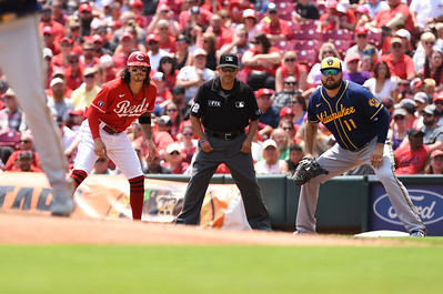 Cincinnati Reds' Jonathan India gets a lead off first as Milwaukee's Rowdy Tellez holds on Sunday afternoon at Great Amercian Ballpark.  MARTY CONLEY/ FOR THE DAILY INDEPENDENT