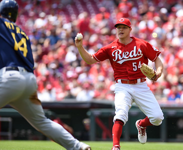 Cincinnati Reds pitcher, Sonny Gray catches up Milwaukee's Jace Peterson in a run down on Sunday afternoon at Great Amercian Ballpark.  MARTY CONLEY/ FOR THE DAILY INDEPENDENT