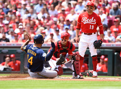 Cincinnati Reds catcher, Tucker Barnhart applies the tag to Jace Peterson of Milwaukee for the out on Sunday afternoon at Great Amercian Ballpark.  MARTY CONLEY/ FOR THE DAILY INDEPENDENT