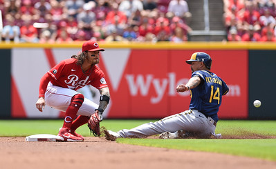 Jace Peterson of the Milwaukee Brewers gets into second before Cincinnati's Jonathan India gets the throw on Sunday afternoon at Great Amercian Ballpark.  MARTY CONLEY/ FOR THE DAILY INDEPENDENT