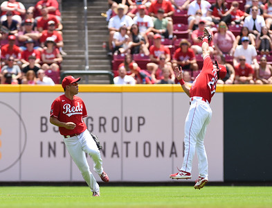 Cincinnati's shortstop, Mike Freeman stretches to make the catch in front of teammate, Shogo Akiyamaon on Sunday afternoon at Great Amercian Ballpark.  MARTY CONLEY/ FOR THE DAILY INDEPENDENT
