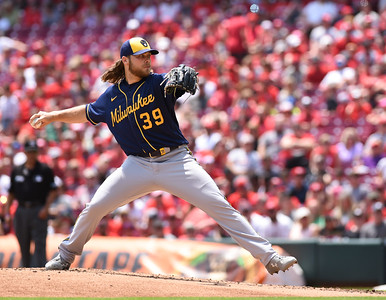Milwaukee Brewers pitcher, Corbin Burnes throws a pitch against the Cincinnati Reds on Sunday afternoon at Great Amercian Ballpark.  MARTY CONLEY/ FOR THE DAILY INDEPENDENT