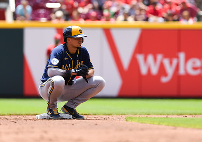 Milwaukee's Willy Adames takes a break at second during a timeout against the Cincinnati Reds on Sunday afternoon at Great Amercian Ballpark.  MARTY CONLEY/ FOR THE DAILY INDEPENDENT