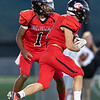 Jakari Eaves hands off the ball to Logan Frye