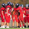 ER's Quarterback Jakari Eaves instructs his team during a huddle