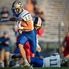 Central's Caleb Daugherty trys to avoid the Eagle defense