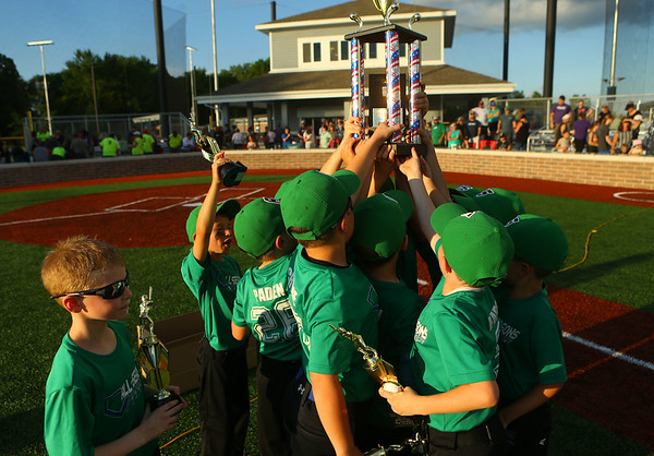 Russiaville's All-Seasons Contracting hoists the trophy after defeating Greentown's Bill's Lawn Care 12-2 for the Rookie Tournament Championship at Championship Park on Wednesday, June 9, 2021.<br /> Kelly Lafferty Gerber   Kokomo Tribune