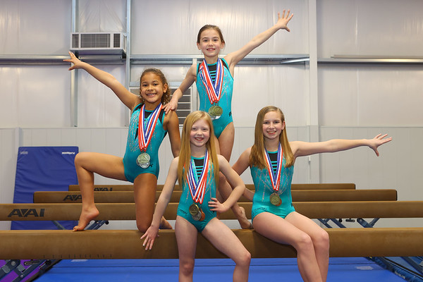 Medal winners from left: Kyra Ward, Paisley Ludlow, Halle Hillis (standing), and Addison Sparling at Kokomo Flipsters on Wednesday, March 17, 2021.<br /> Kelly Lafferty Gerber | Kokomo Tribune