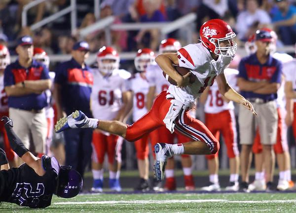 9-17-21   Northwestern vs Cass football Cass' LJ Hillis flies through the air as he's tripped up by NW's Sam Craig. Kelly Lafferty Gerber | Kokomo Tribune